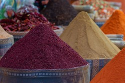 Historical Turkish spice shops in Istanbul Spice Bazaar, colorful spices in buckets. Food spices