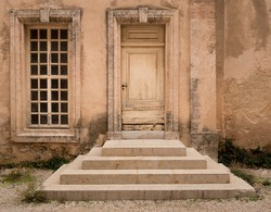 Historical Wooden Door with Symmetrical Stone Steps and Window of Same Size, The Chapel of la Vieille Charite, Marseille, France