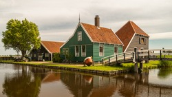 Historical wooden windmill village Zaanse Schans Netherlands, wooden wind mill village near Amsterdam.