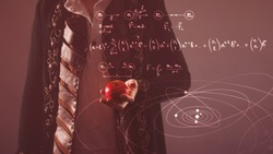History of science, concept. Isaac Newton with Apple in hand. Gravity and the theory of gravity. Research in physics.