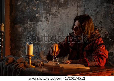 History of science, concept. Nicholas Copernicus author of the heliocentric system of the world, the scientific revolution of the Renaissance. History of scientific progress Foto stock ©