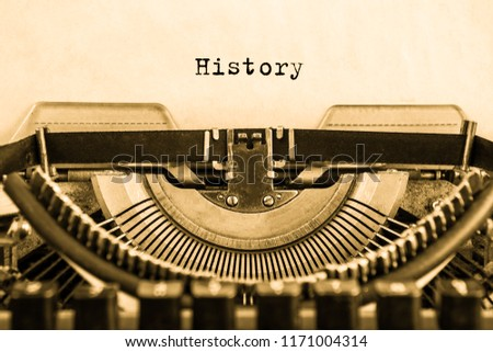 History typed on an vintage typewriter, old paper.