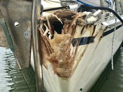 Hit boat damaged bow sitting in Phuket boat Lagoon wait for repair