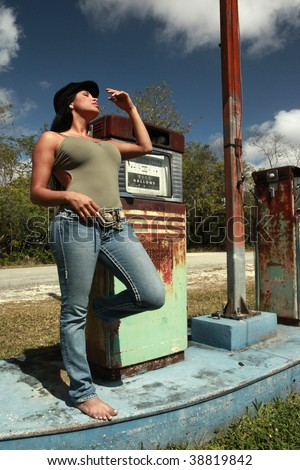 Hitchhiker and a vintage gas pump