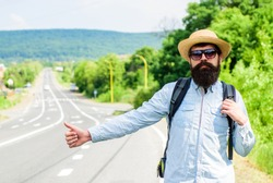 Hitchhiker with special gesture. Man try stop car thumb up. Hitchhiking one of cheapest ways traveling. Hitchhikers risk being picked up by someone who is unsafe driver or personally dangerous.