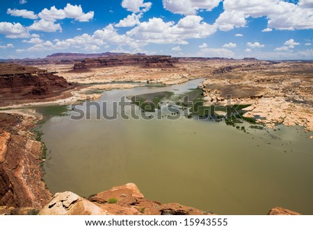Hite Overlook looking down into Lake Powell in Glen Canyon National Recreation Area, Utah on a party cloudy day