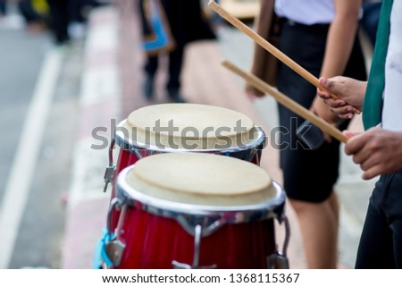Hitting an African drums. Play on a musical instrument Drummer. Drum sticks hitting the drum .  Drum sticks hit on the drum