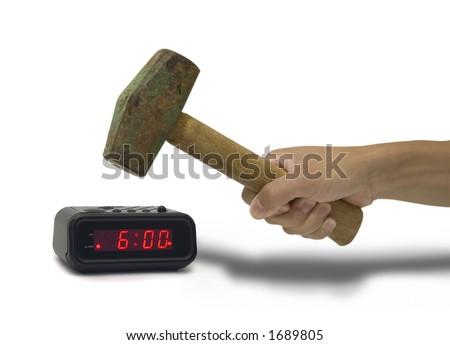 hitting an alarm clock with a sledge hammer