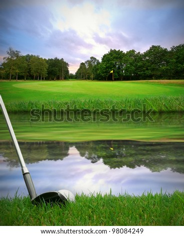 hitting golf ball over water hazard from fairway onto green