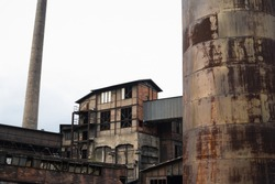 Hlubina mine, The Lower Vitkovice area, Ostrava, Czech Republic / Czechia - ruin of abandoned old historical industrial budiling. Architecture is desolated, corroded and ruined.