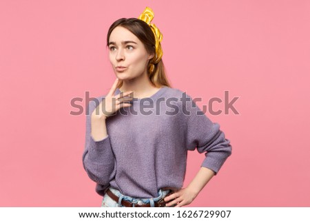 Hmm, let me think. Reflection, contemplation and prudence concept. Isolated image of attractive trendy girl with yellow headscarf looking up and holding fore finger on her chin, deepin in thoughts Photo stock ©