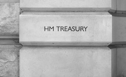 HMRC (Her Majesty Treasury) sign in London, UK in black and white