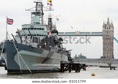 HMS Belfast and Tower bridge in the background in London England