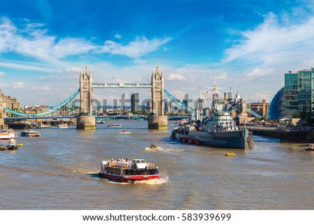 HMS Belfast warship and Tower Bridge in London in a beautiful summer day, England, United Kingdom