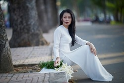 Ho Chi Minh city, Viet Nam: A beautiful and innocent Vietnamese schoolgirl in a white ao dai