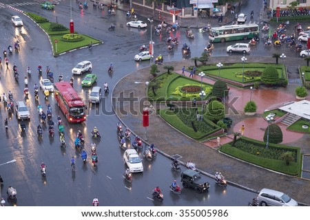 HO CHI MINH city, VIET NAM - JULY 20, 2015: Colorful, vibrant scene of traffic, dynamic, crowded city with trail on street, Quach Thi Trang roundabout at Ben Thanh market, Vietnam