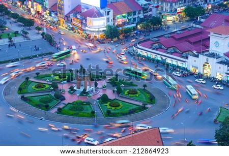 HO CHI MINH CITY, VIETNAM- AUG 21: Impression, colorful, vibrant scene of Asia traffic, dynamic, crowded city with trail on street, Quach Thi Trang roundabout at Ben Thanh market, Vietnam, Aug 21,2014