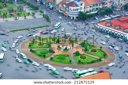 HO CHI MINH CITY, VIETNAM- AUG 21: Impression scene of Asia traffic, dynamic, crowded city with group of motorbike move on street, Quach Thi Trang roundabout at Ben Thanh market, Vietnam, Aug 21,2014