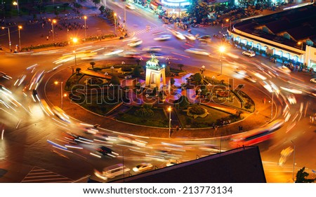 HO CHI MINH CITY, VIETNAM- AUG 21: Impression scene of Asia traffic, dynamic, crowded city with trail of vehicle on street, Quach Thi Trang roundabout at Ben Thanh market, Vietnam, Aug 21,2014