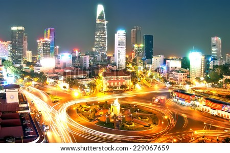 HO CHI MINH CITY, VIETNAM- AUG 18: Impression scene of Asia traffic, dynamic, crowded city with trail of vehicle on street, Quach Thi Trang roundabout at Ben Thanh market, Vietnam, Aug 18,2014