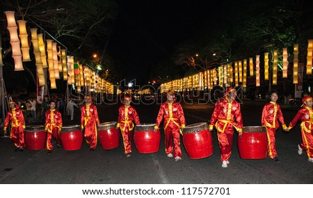 HO CHI MINH CITY, VIETNAM - FEBRUARY 13: A group of  unidentified local boys carry their drums during the Tet Lunar New Year celebrations on February 13, 2007 in Ho Chi Minh City, Vietnam.