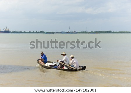 HO CHI MINH CITY, VIETNAM - JUN 21: Rowboat are using commonly for the people living on the riverbank of Saigon river where passing over Can Gio biosphere reserve area on Jun 21, 2013