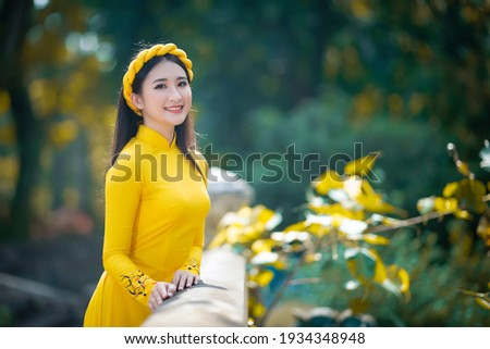 Ho Chi Minh City, Vietnam: Portrait women in yellow ao dai Vietnam, The Ao dai ( long-dress Vietnamese) is traditional costume of Vietnamese woman