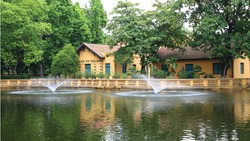 Ho Chi Minh's Residence near the pond with fountain in Hanoi, Vietnam
