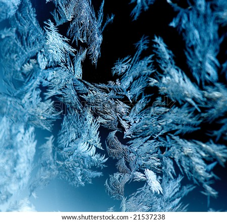 Hoarfrost pattern on dark glass - stock photo