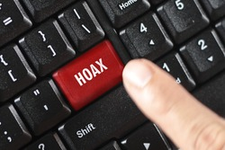 hoax word on red keyboard button