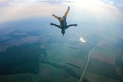 Hobbies. Free people prefere active sports. Bird men conquers sky. Flying people in professional suit. Extreme as a hobby.