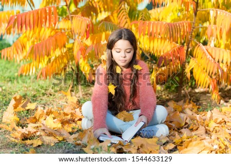 Hobby and interests. Girl read book autumn day. Little child enjoy learning at backyard or park. Kid study with book. Self education concept. Child enjoy reading. Schoolgirl study. Study every day.