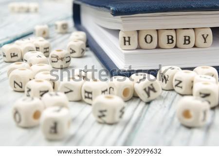 HOBBY word written on wood block. Wooden ABC