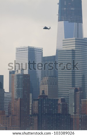 HOBOKEN - MAY 23: A military helicopter flies along the Hudson River over Manhattan during the Parade of Sails on May 23, 2012 in Hoboken, NJ. The parade marks the start of Fleet Week.