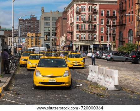 Hoboken, NJ USA -- September 19, 2017 --Yellow Taxi cabs are lined up outside the Hoboken bus and train terminal. Editorial Use Only. Editorial use only.