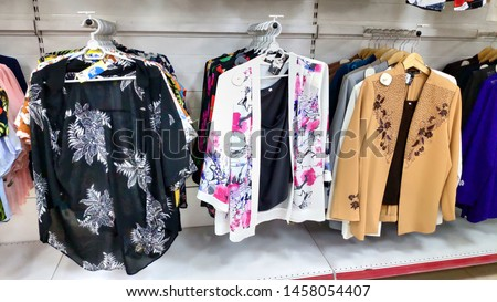 Hochiminh city, Vietnam - July 01 2019: Beautiful fashionable women clothes various size top dresses blazers on supermarket shelf colorful design wardrobe rack #1458054407