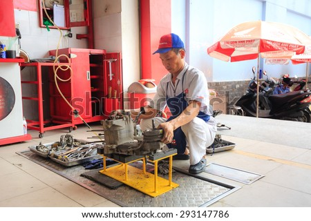 Hochiminh City, Vietnam - June 23, 2015: Professional motorcycle repairman at a service center of Honda motorcycles in Ho Chi Minh City, Vietnam