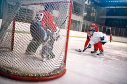 hockey goals, players shoot the puck and attacks goalkeeper
