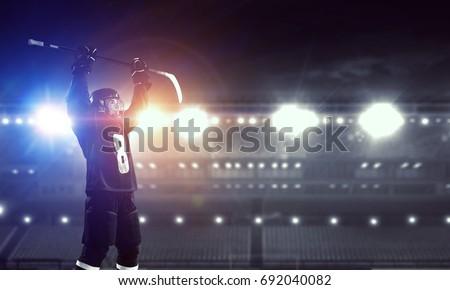 Hockey player celebrating victory. Mixed media