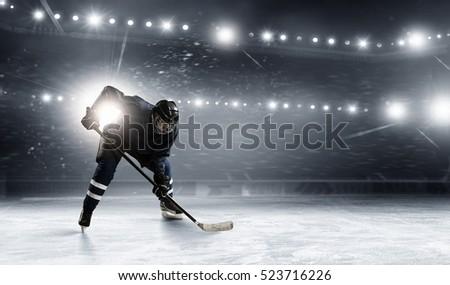 Hockey player on the ice . Mixed media