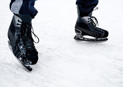 Hockey player. Skate. Winter sport.