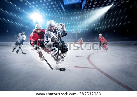 Hockey players shoots the puck and attacks