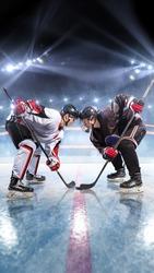 Hockey players starts game. around Ice rink arena