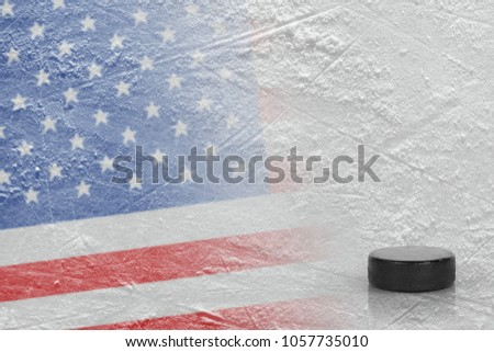 Hockey puck and the image of the American flag on the ice. Concept, hockey