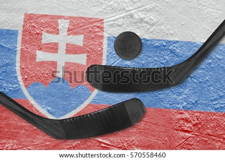 Hockey puck, hockey sticks and image of the Slovak flag on the ice. Concept