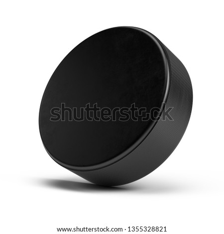 Hockey puck isolated on white - 3d rendering