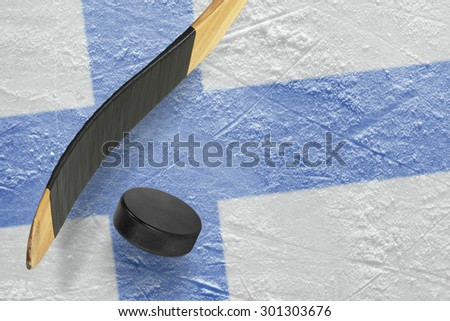 Hockey puck, stick and a fragment of an image of the Finnish flag