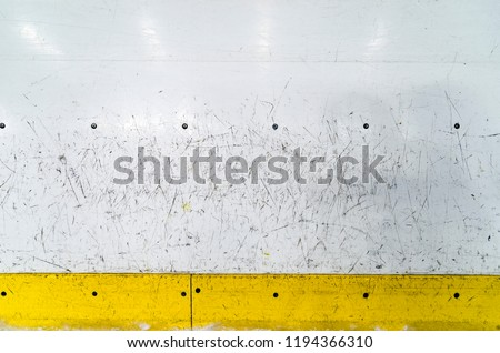 Hockey rink boards with scratched and damaged surface #1194366310