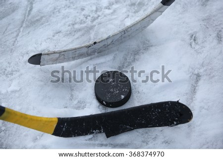 Hockey Stick and Puck on the Ice. Face-off