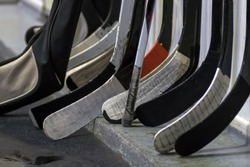 Hockey sticks near the locker room before the game